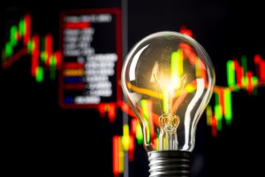 Business success with stock graph and light bulb