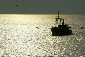 A fishing boat leaves port © European Commission